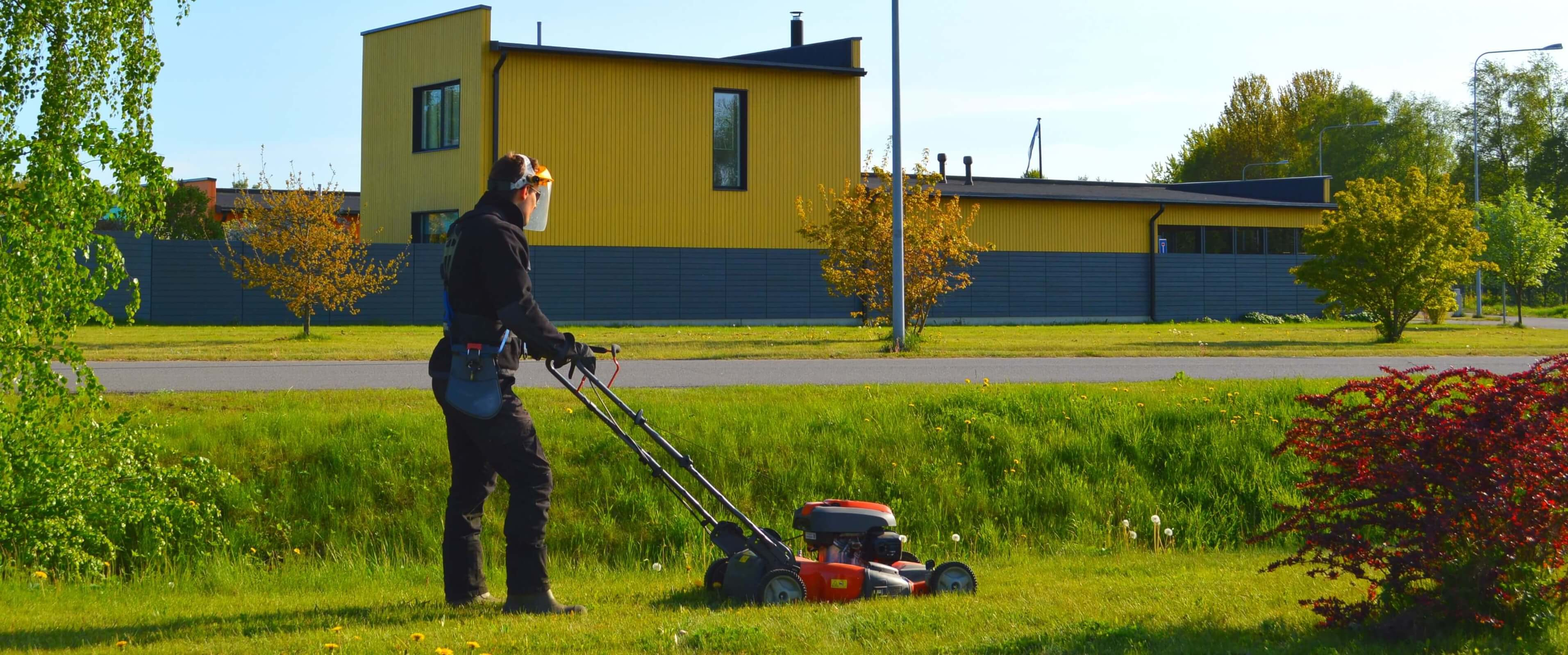 Landscaping in the autumn season: maintenance of the territory, leaves cleaning and the last lawn mowing  before winter